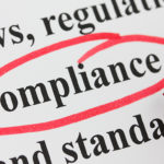 Image of the word compliance circled in red marker